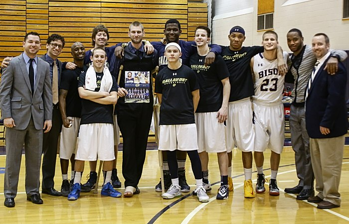 Gallaudet men's basketball team with senior Orion Palmer