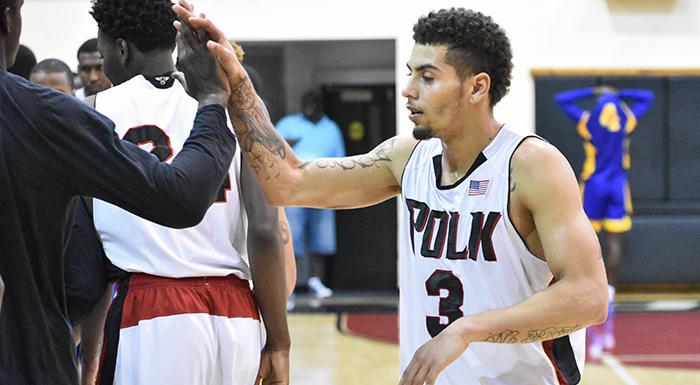 Teammates congratulate Elijah Cottrill after his basket gave the Eagles a 73-72 win. (Photo by Tom Hagerty, Polk State.)