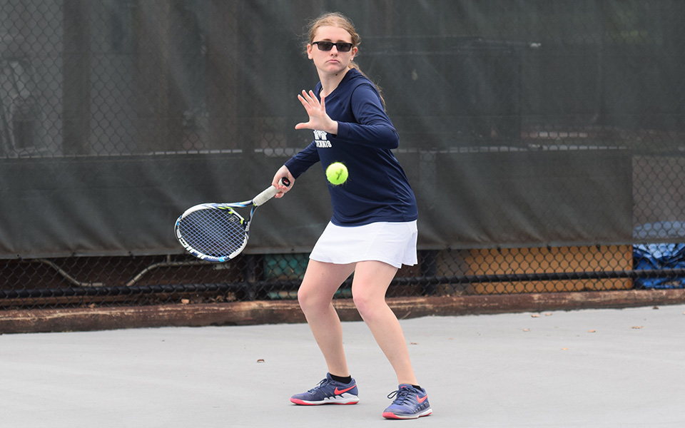 Sophomore Destiny George returns a shot in doubles action versus Cedar Crest College on Hoffman Courts during the fall 2018 season.