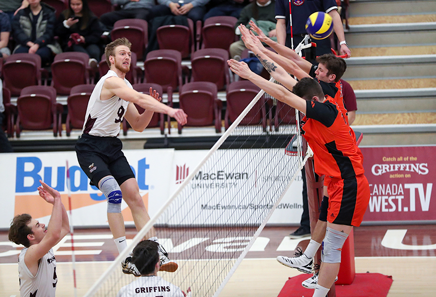 Max Vriend hits one off of a Thompson Rivers University double block on Saturday night. He finished with a match-high 22 kills in the final outing of his MacEwan Griffins career (Eduardo Perez photo).