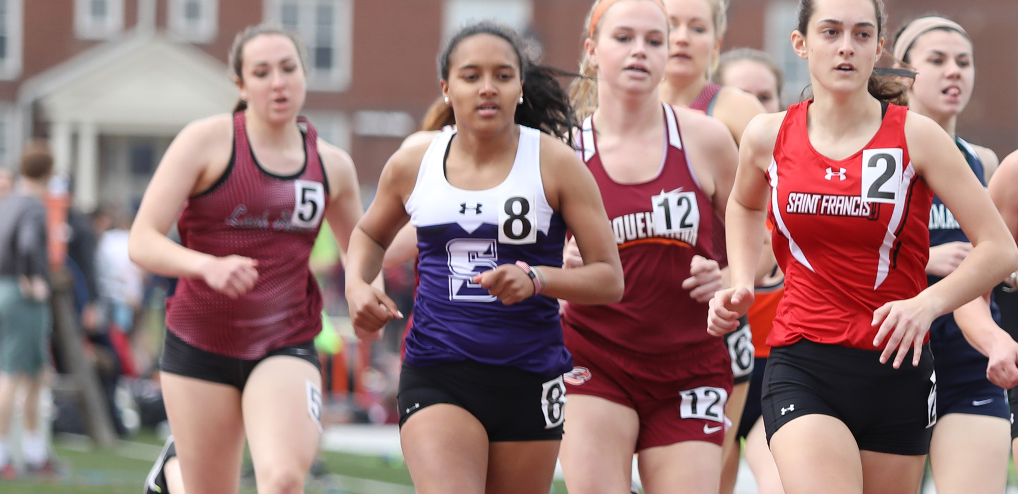 Junior Nora Boussatta won the 800 meter run on Saturday for the Royals at the Monarch Open. © Photo by Timothy R. Dougherty / doubleeaglephotography.com