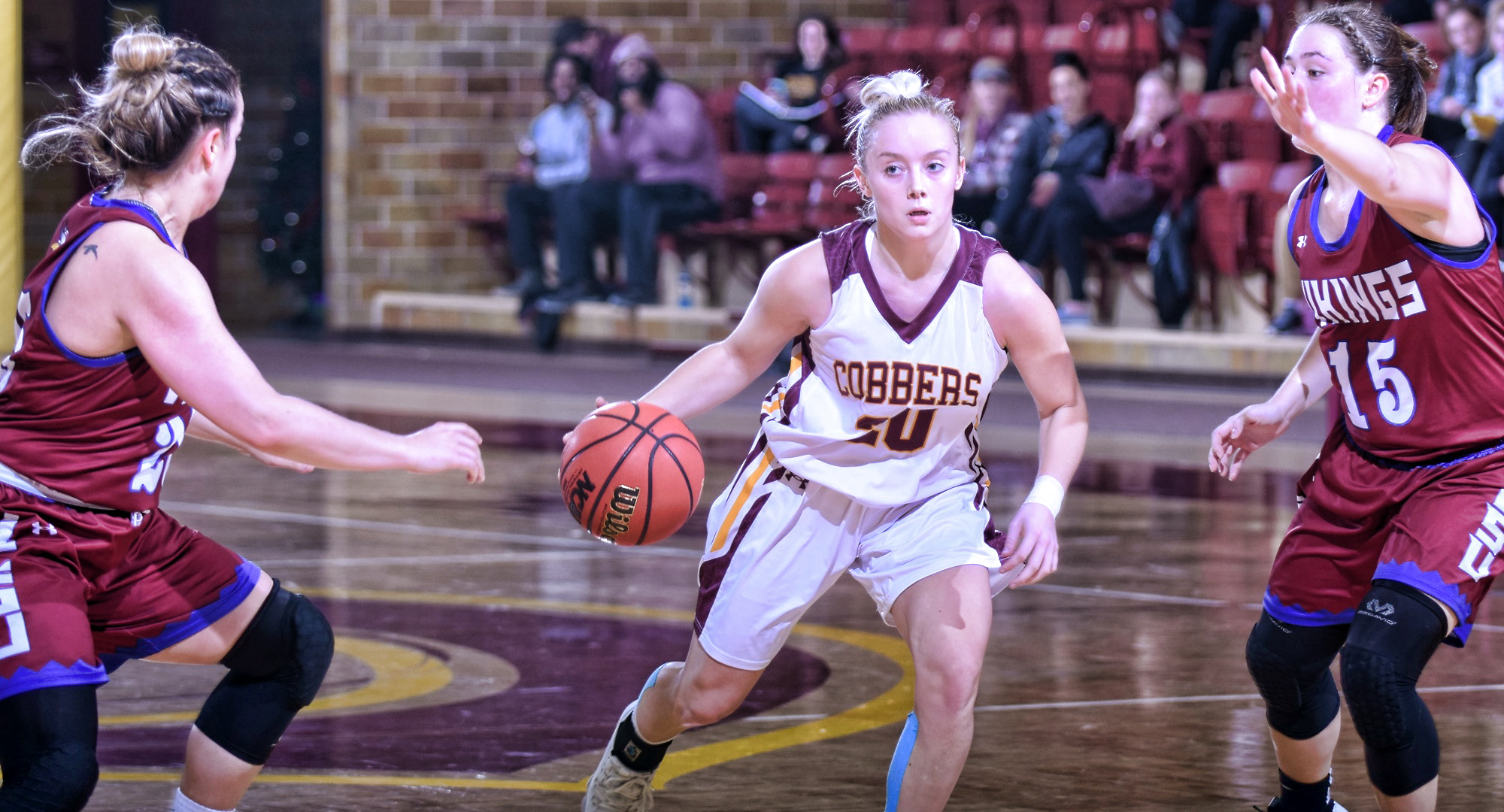 Sophomore Amber Lingen dribbles the ball to the basket during the Cobbers' home opener with Valley City St. She finished with a career-high 22 points.
