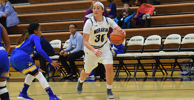 Camille McPherson '17 looks to drive to the basket in a game against Goucher College.