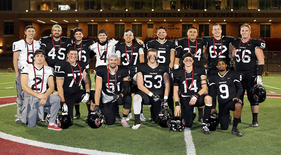 The 2019 Chapman football seniors pose while being honored on Senior Night.