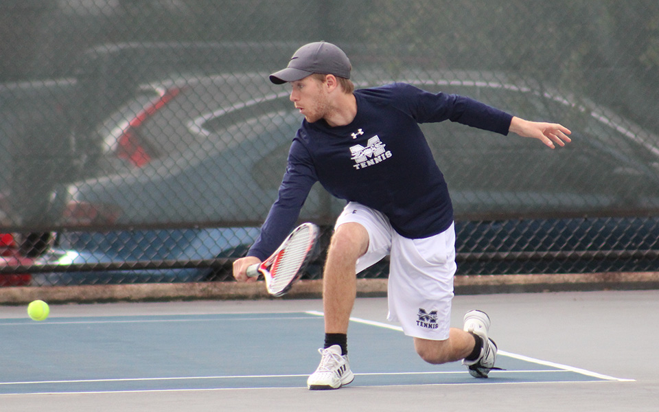 Sophomore Mason Hudnall returns a shot during doubles action versus Eastern University on Hoffman Courts.