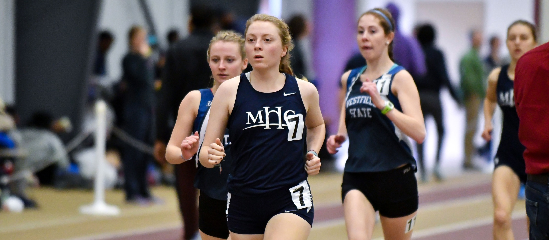 Mia Barnes indoor track and field action photo.