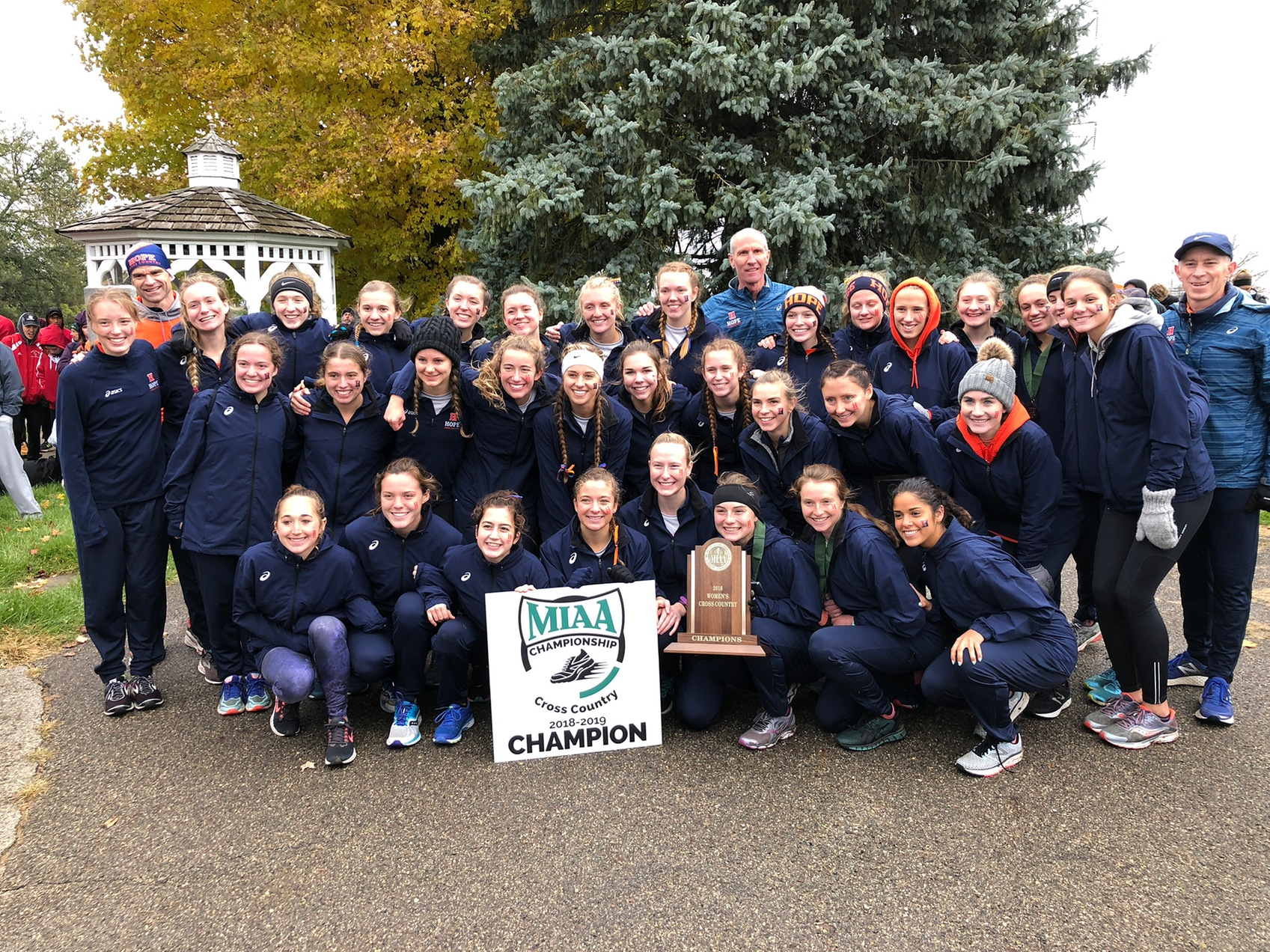 Hope runners pose together with the MIAA trophy