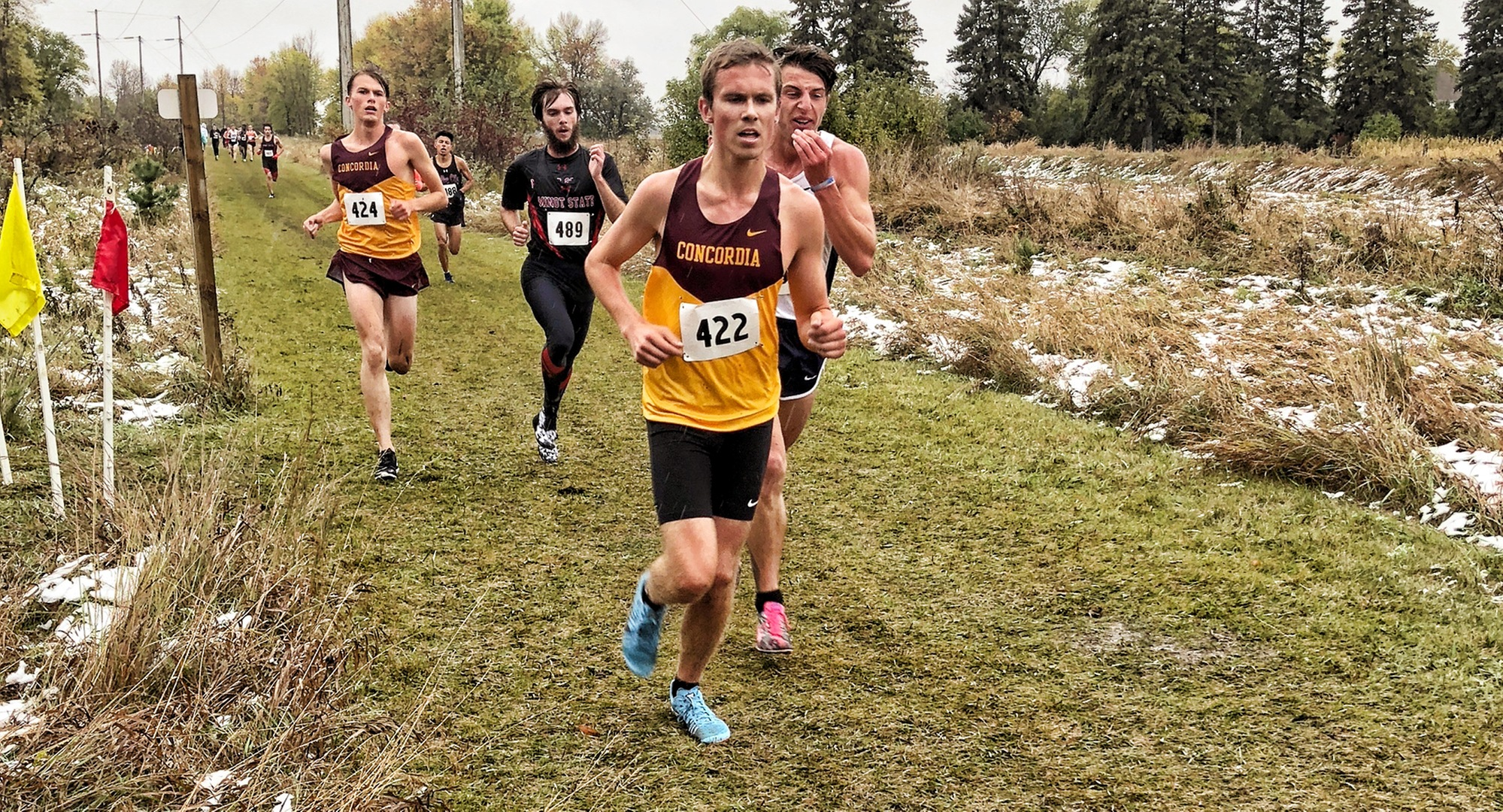 Freshman Nolan Christenson jumps in front of the pack on his way to a 9th-place finish at the Jimmie Invitational.