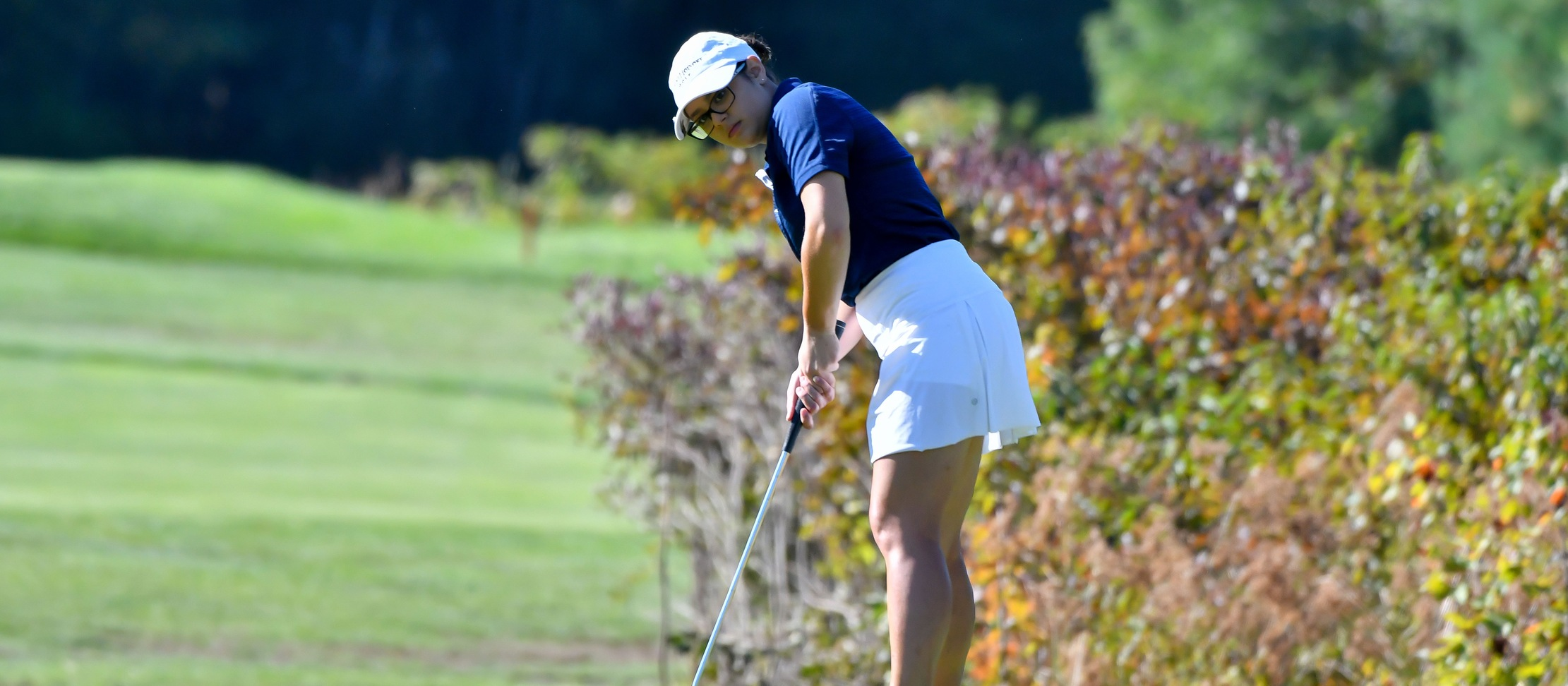 Action photo of Lyons golf player Stephanie Spitzer.
