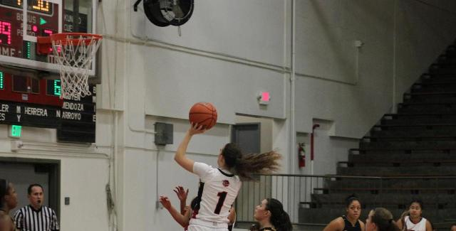 Ashley Whisler puts up a shot in the key against Cypress. Whisler scored 15 points in the Dons 84-66 loss to the Chargers. (Photo courtesy of TonyMcAndrew)