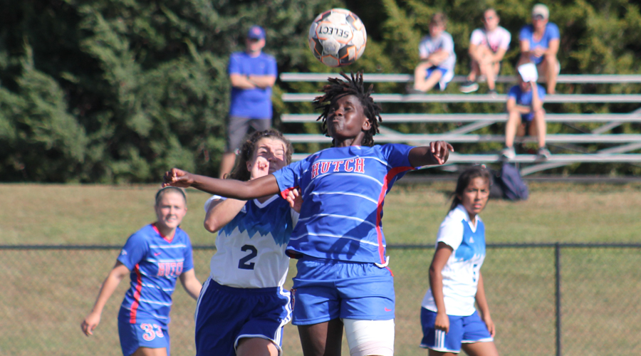 Naomi Waithira battles for the ball with a Barton defender during Hutchinson's 4-2 loss to the Cougars on Wednesday in Great Bend. (Photo courtesy Todd Moore/Barton Sports Information)