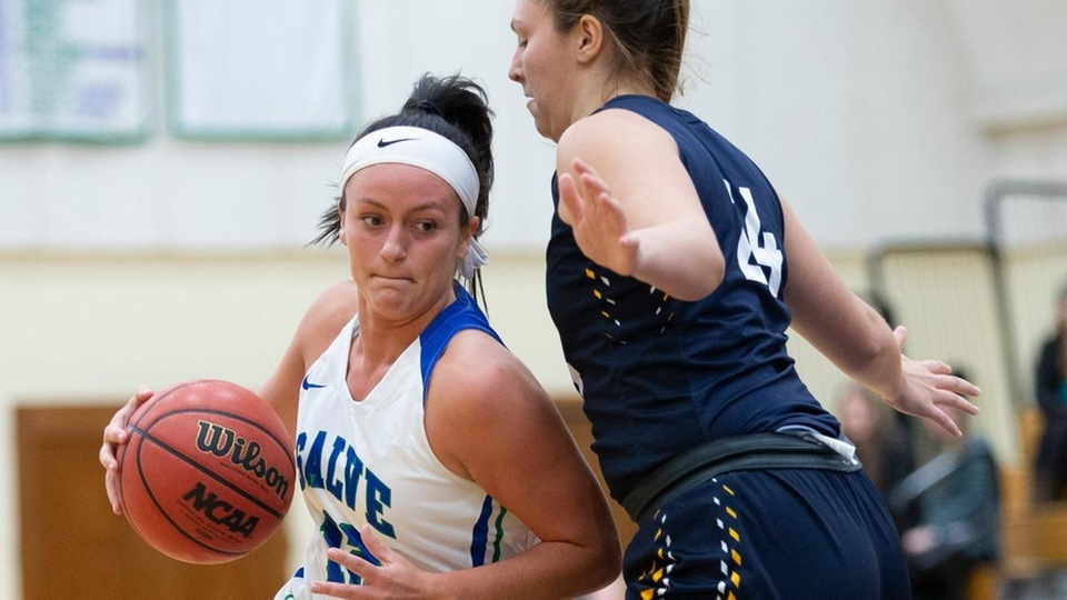 Salve Regina graduate student Lauryn Becker driving past Kyra Rideout in second half action of season opener. (Photo by Rob McGuinness)