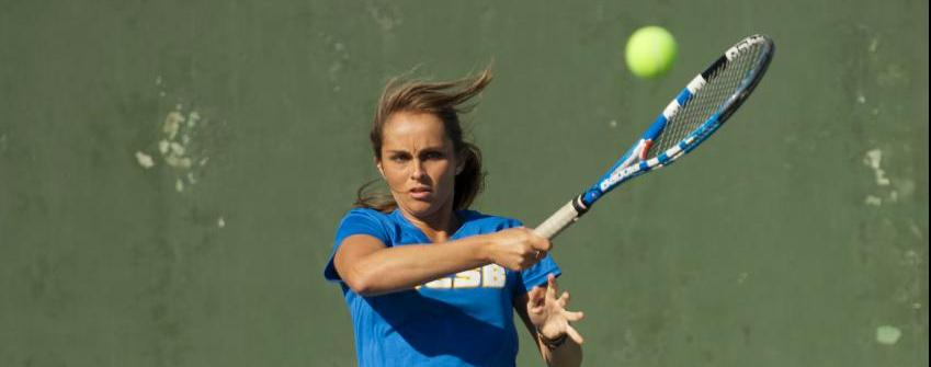 Erica Cano follows through on a forehand