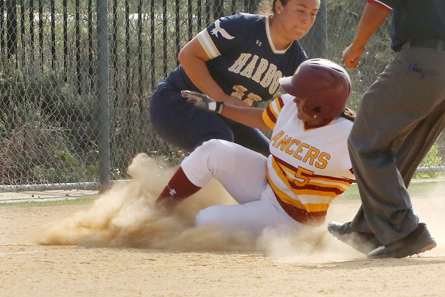 Lancer Nathalia Velasquez slides into third in a recent game, photo by Richard Quinton.
