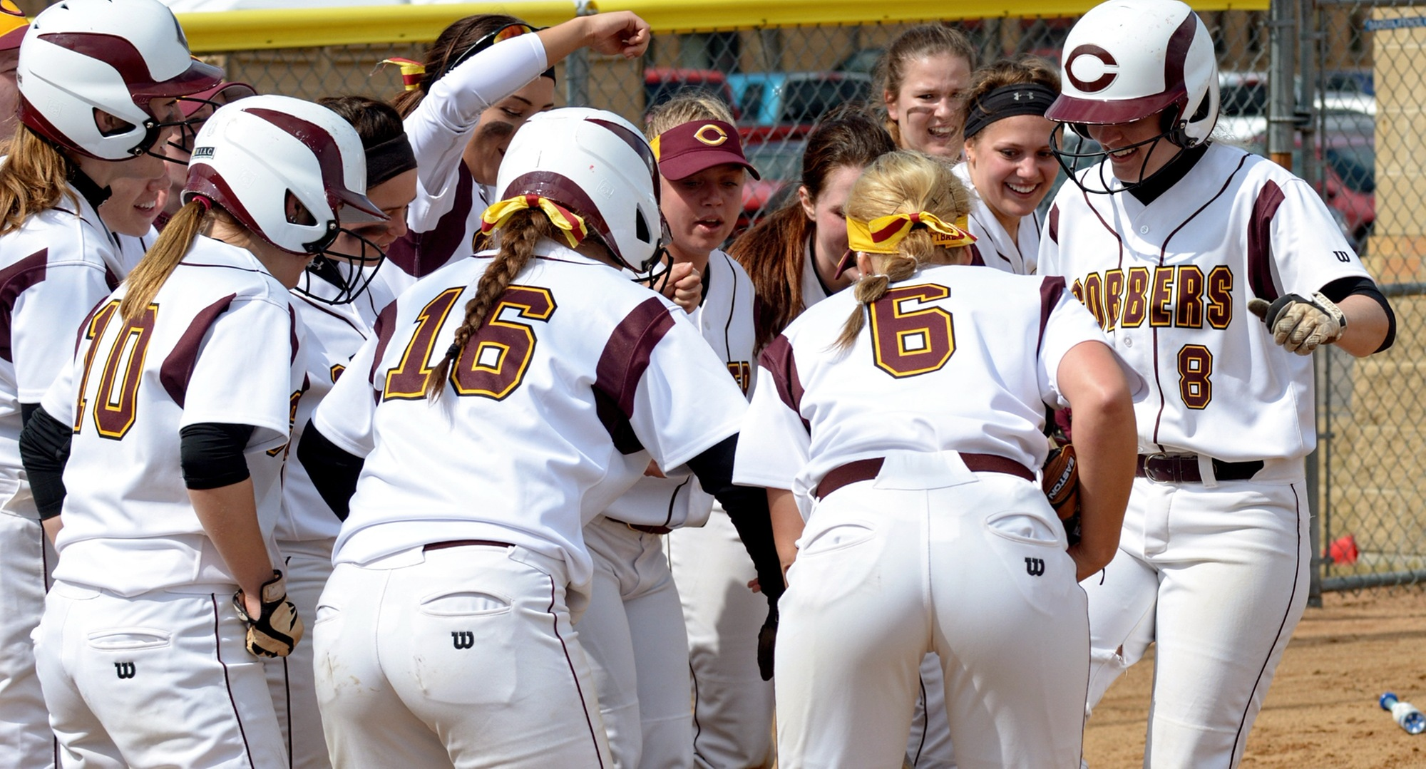 Sophomore Sydney Roberts (#8) gets ready to touch home plate after one of her two home runs in the Cobbers' MIAC opener against St. Benedict.