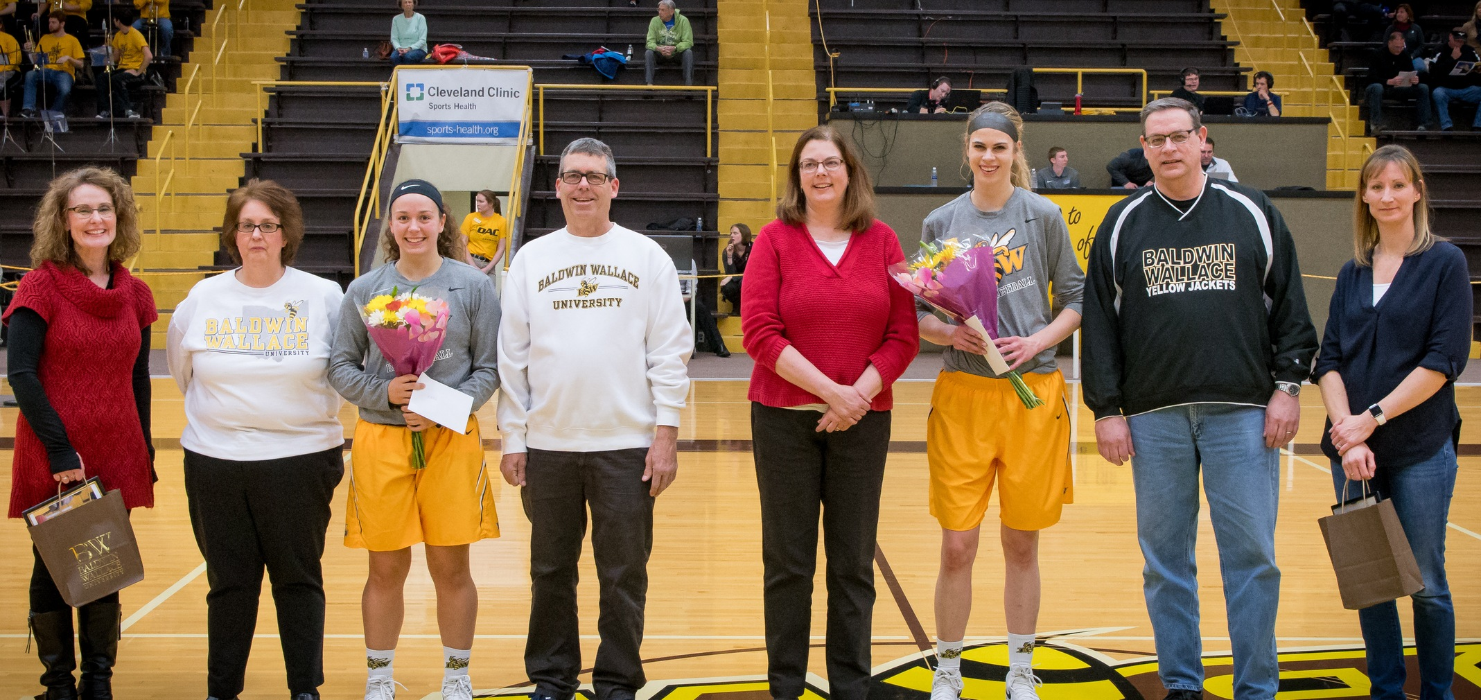Seniors Katie Smith and Megan Schubert with their families (Photo courtesy of Jesse Kucewicz)