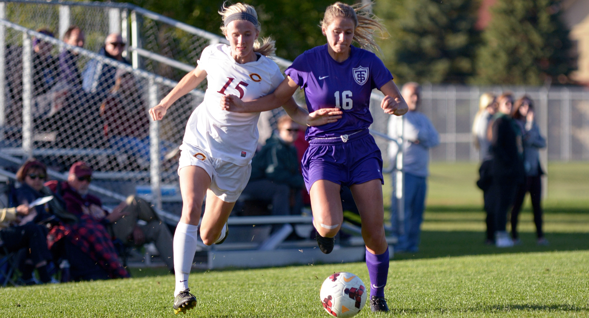Senior Emily Payne battles for the ball on the right wing during the Cobbers' game with #14 St. Thomas. Payne scored her second goal in the last three games in the 2-1 loss.