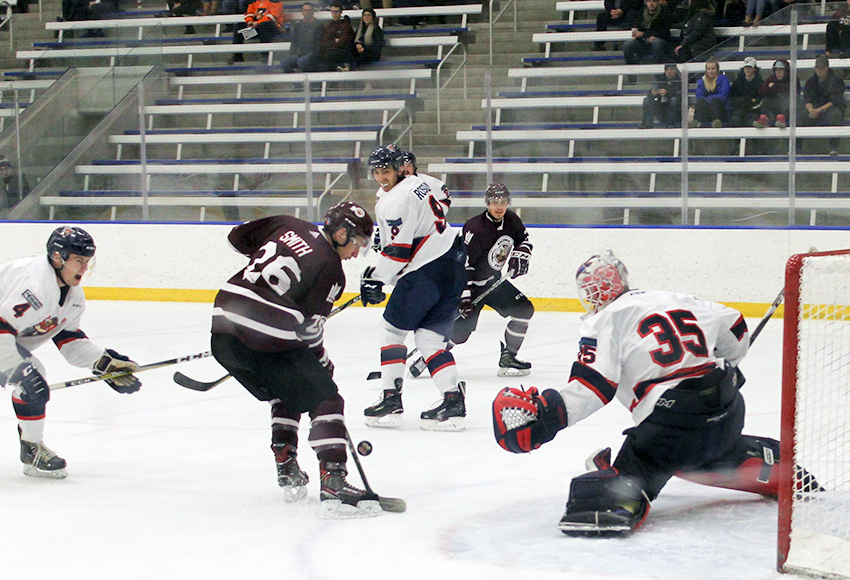 Dallas Smith gets a chance in front of Portage goaltender Jordan Brant on Friday night (Melbourne Disbrowe photo).