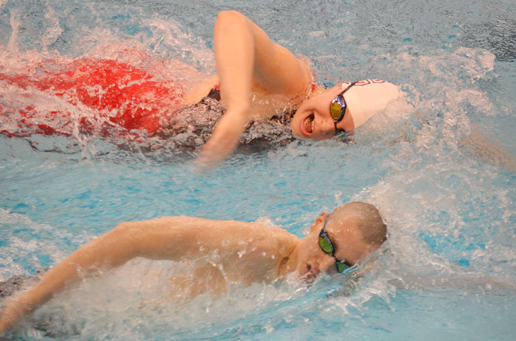 Swimming & diving teams fall to Calvin in season-opening dual meets