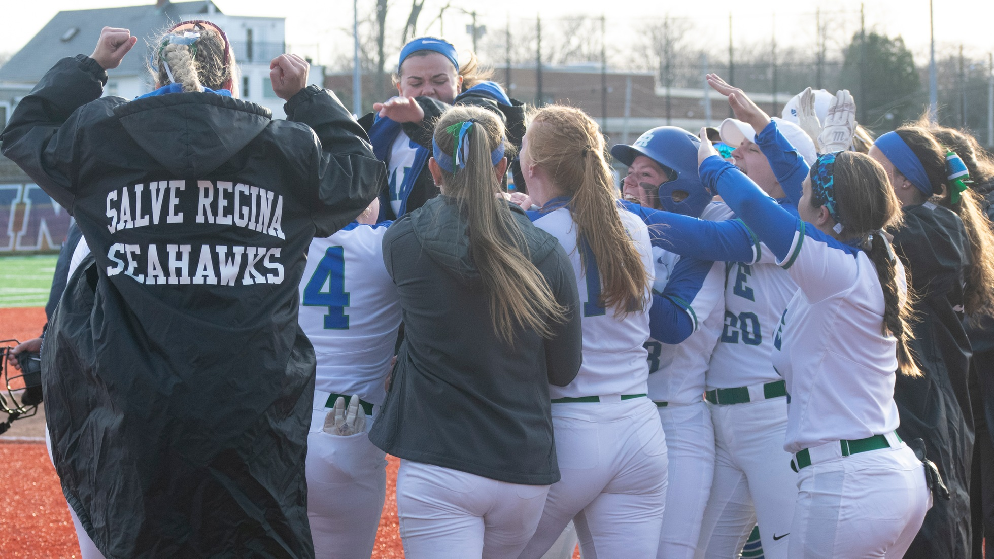 Nikki Vanelli, unseen in photo as she's mobbed by her jubilant teammates, touches home plate with her walk-off two-run home run in Salve Regina softball 4-3 victory in Game One with UMass Dartmouth. The Seahawks swept the Corsairs with a 6-5 win in the nightcap. (Photo by Jaime Wheeler)