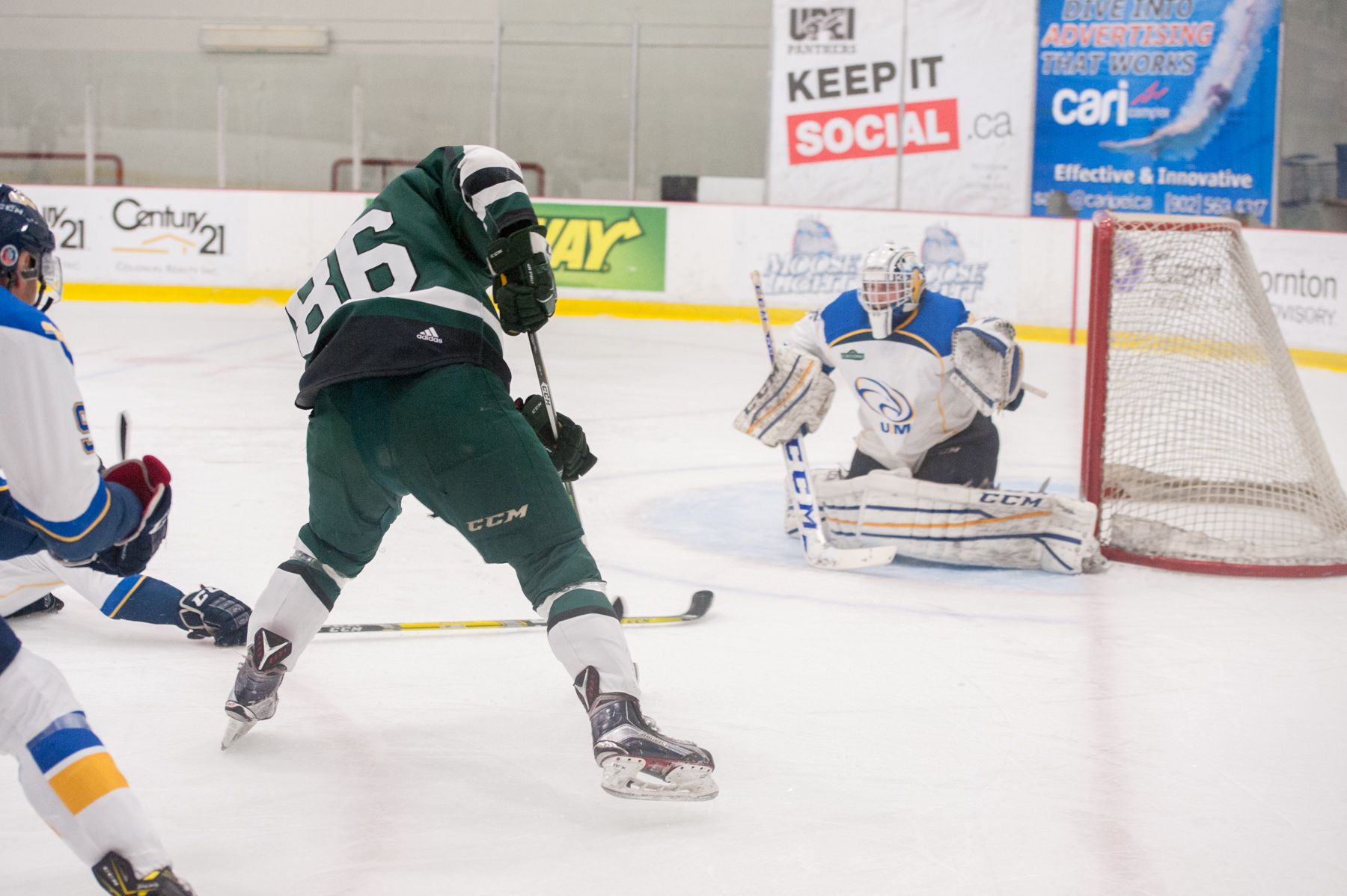 Panther forward Marcus power drives to the net for a scoring chance.