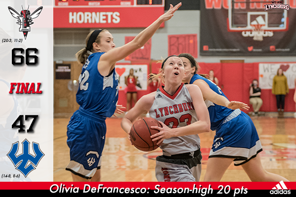 Olivia DeFrancesco goes past a W&L defender for a layup.