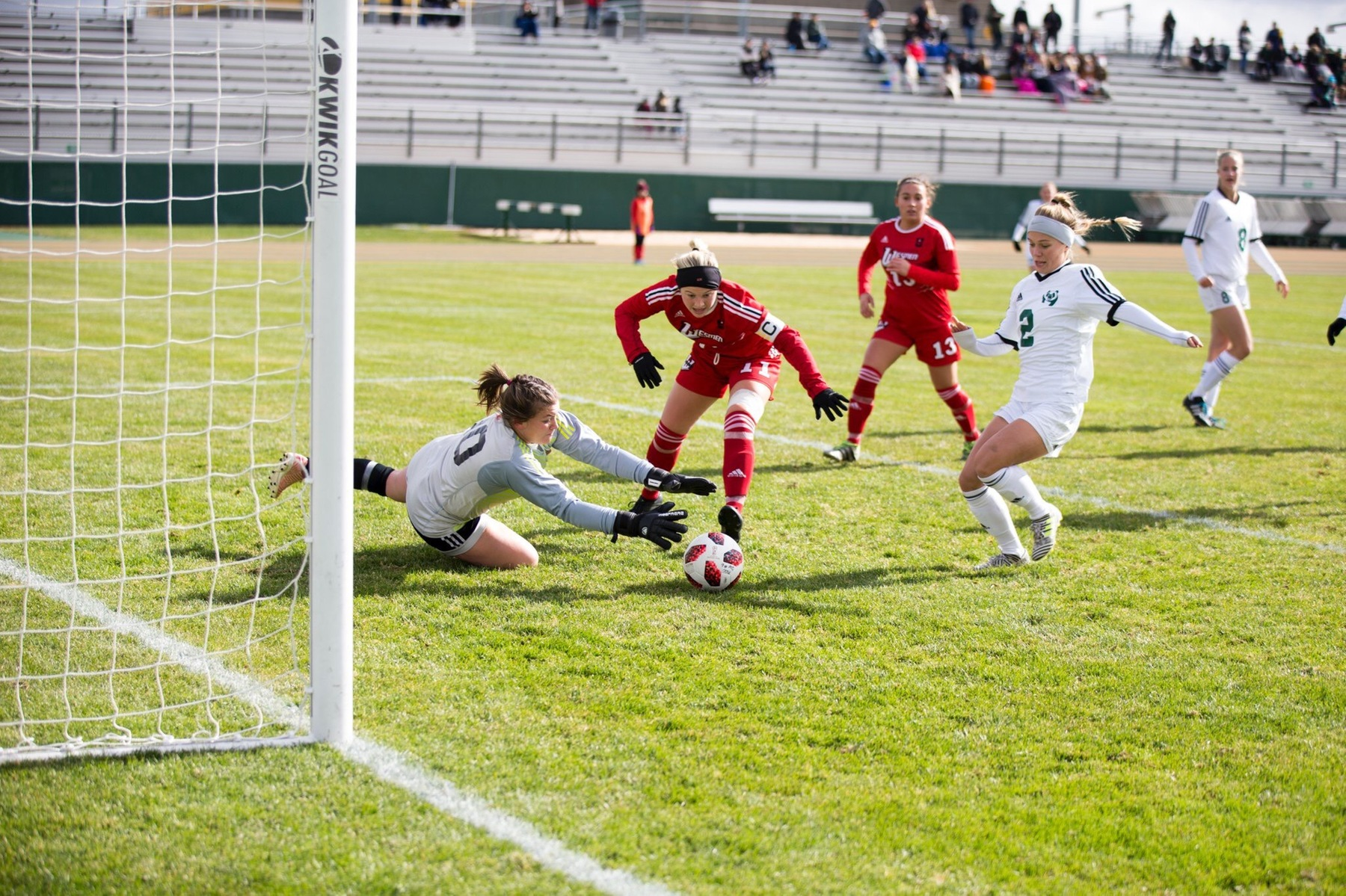 Wesmen goalie Madyson Fordyce makes one of her nine saves while defender Amy Clayton (centre) looks on Saturday in Edmonton. (Alberta Athletics photo)