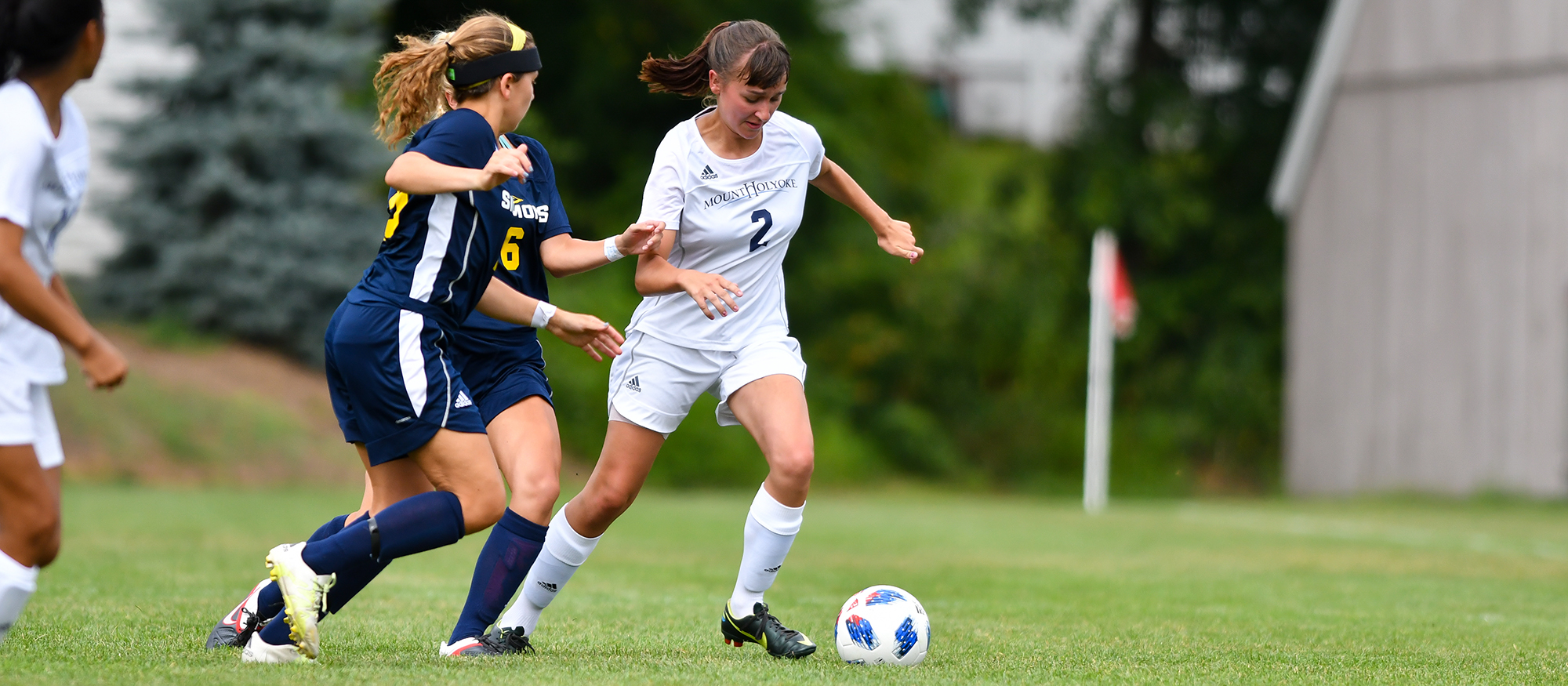 Action photo of Lyons soccer player, Chloe Bernier.