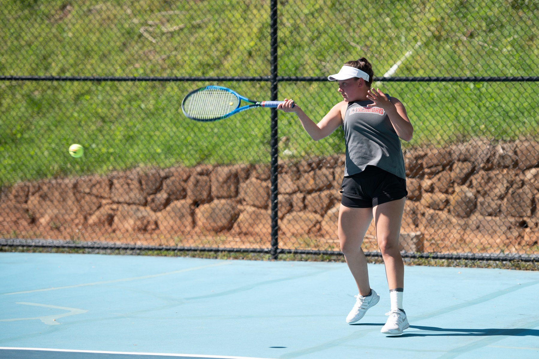 Christina Harris playing in a tennis match