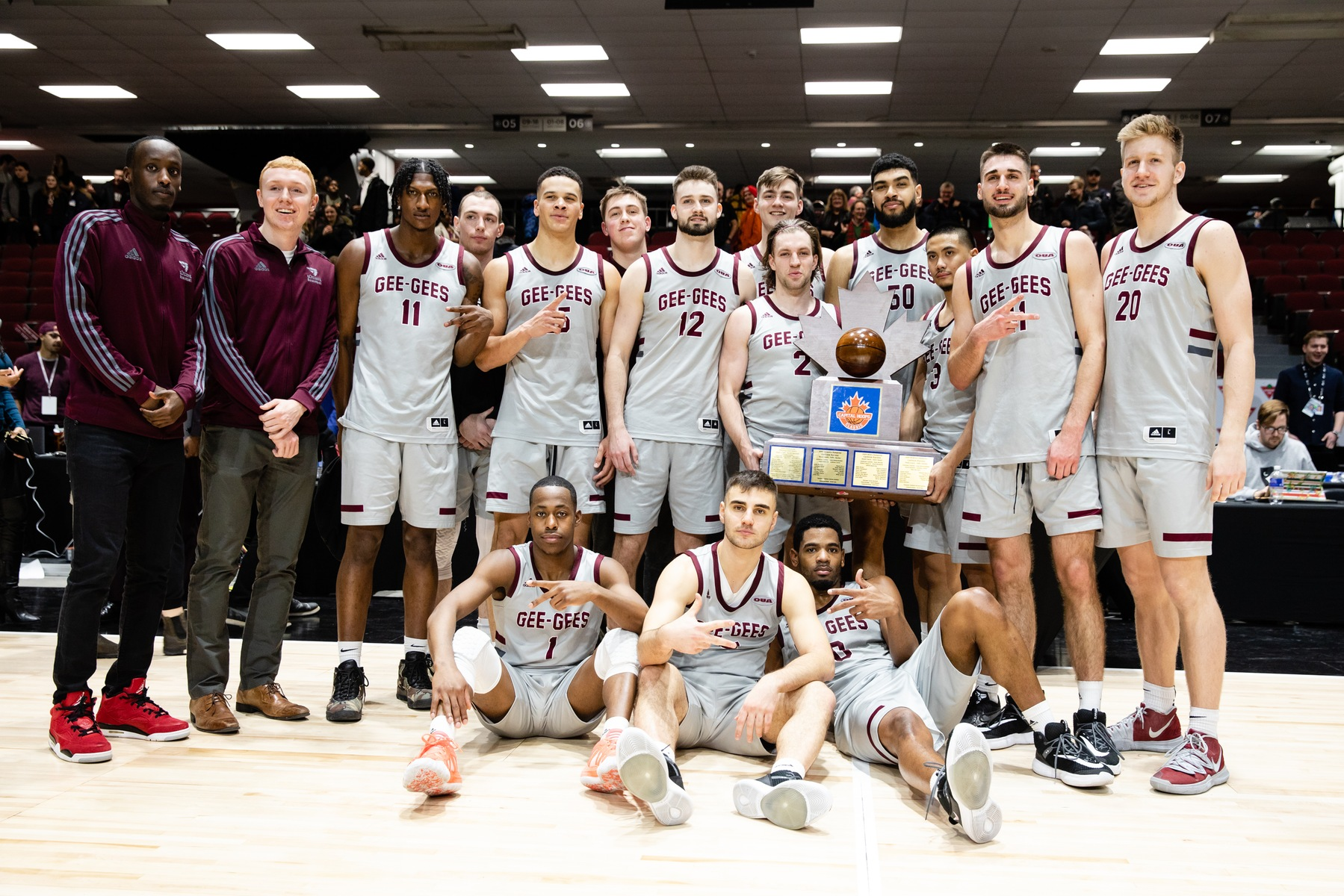 Gee-Gees men's team with the event trophy.