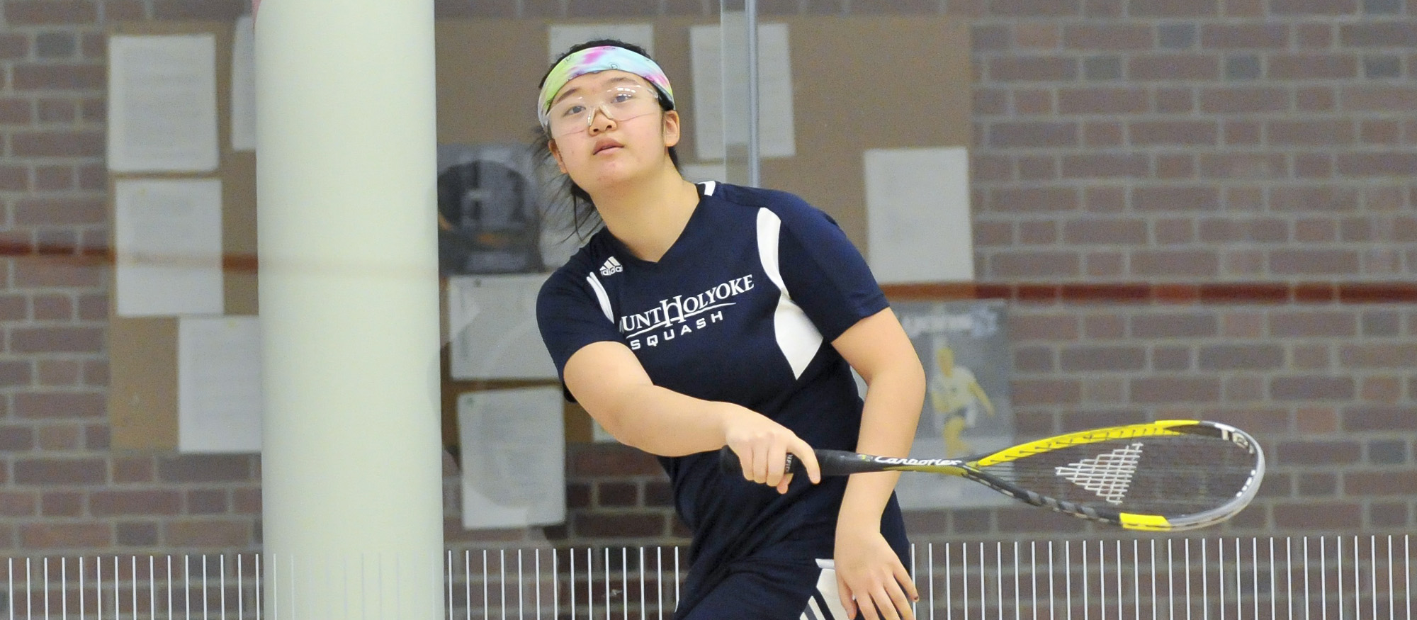 Action photo of Lyons squash player, Emily Chang