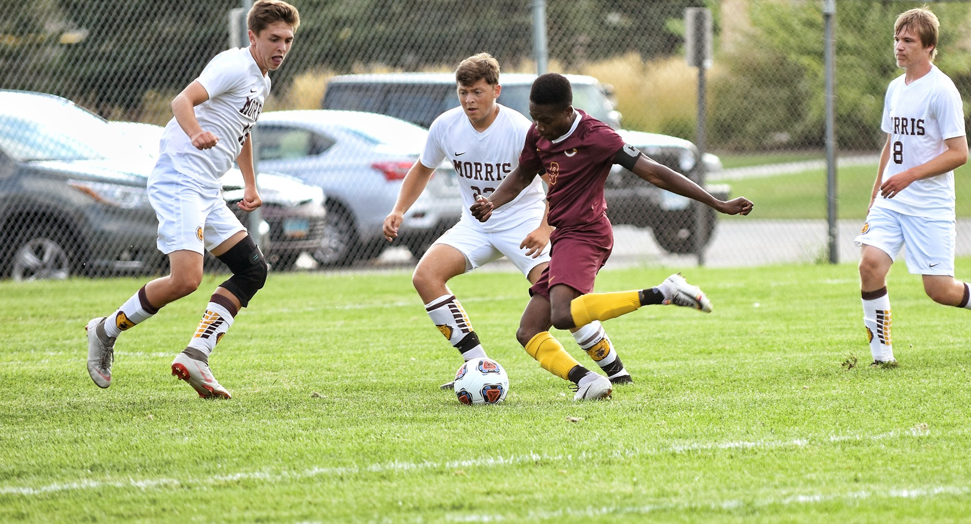 Senior Aronah Mukhtar is surrounded by three Minn.-Morris defenders as he tries to take a shot on goal. Mukhtar had a goal and an assist in the Cobbers' 4-1 win.