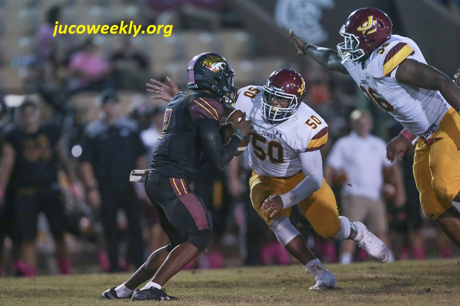 Bobcat defensive linemen Chei Hill (50) and DaShawn Crawford (36) converge on Pearl River quarterback Tavis Williams (7) last week.