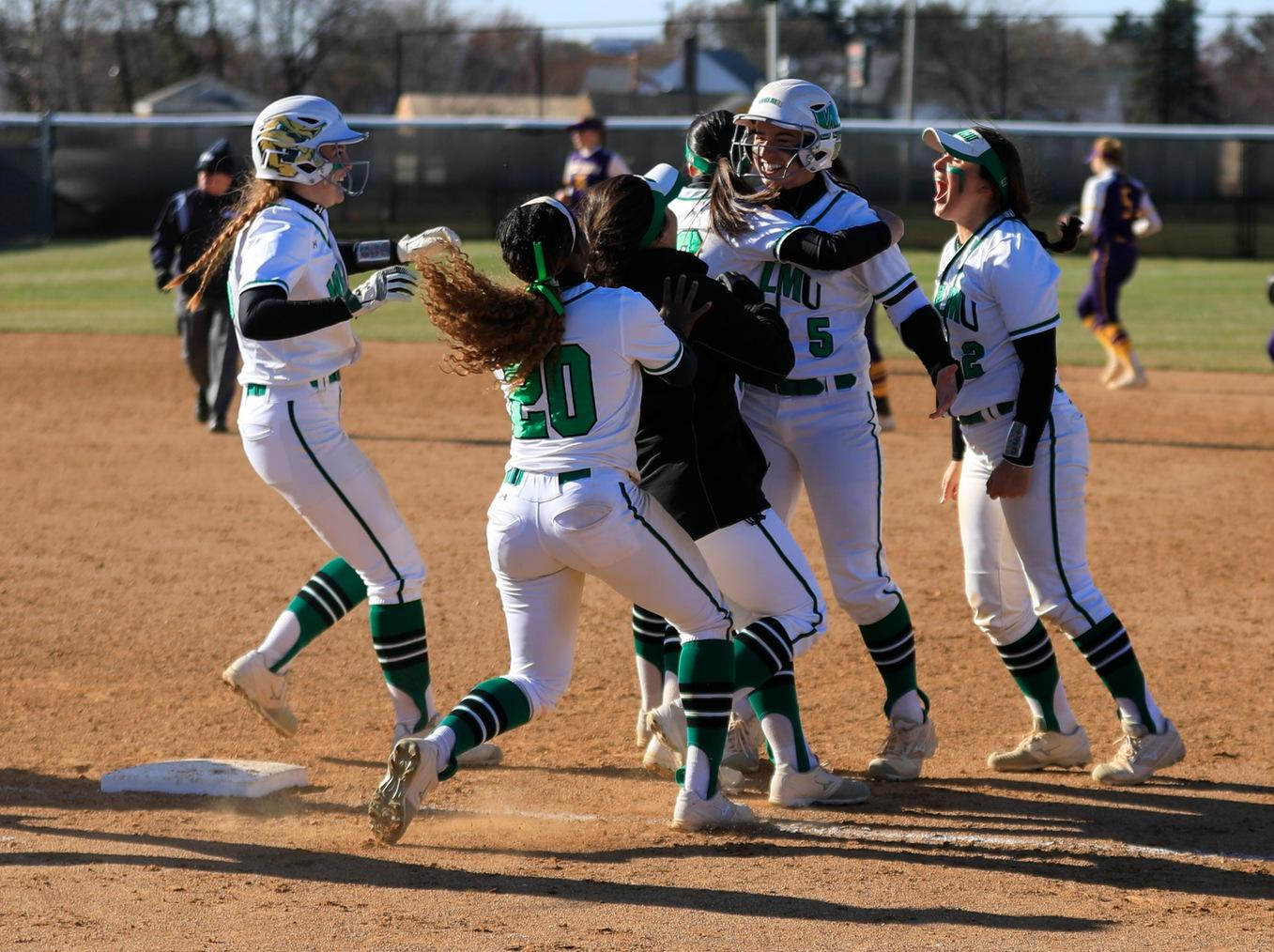 Copyright 2019; Wilmington University. All rights reserved. Photo of the celebration after Angela Antonini's walk-off against West Chester. Photo by Chris Vitale. March 26, 2019 vs. West Chester.