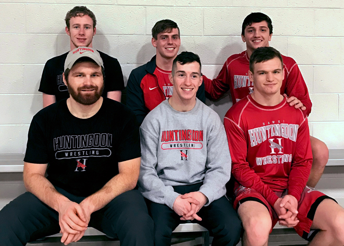 Huntingdon's senior wrestling class has been a part of the first 23 dual-match wins in program history. The fifth-year Hawks set a program record with eight victories this season. (Photo contributed)