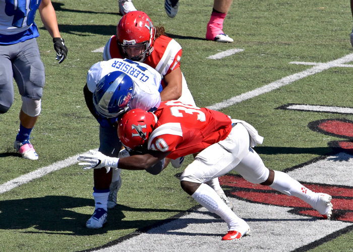 Defensive back Cobi Jones (#30) and linebacker Karl Dorn (#51) combine for a stop in Saturday's win over Brevard.
