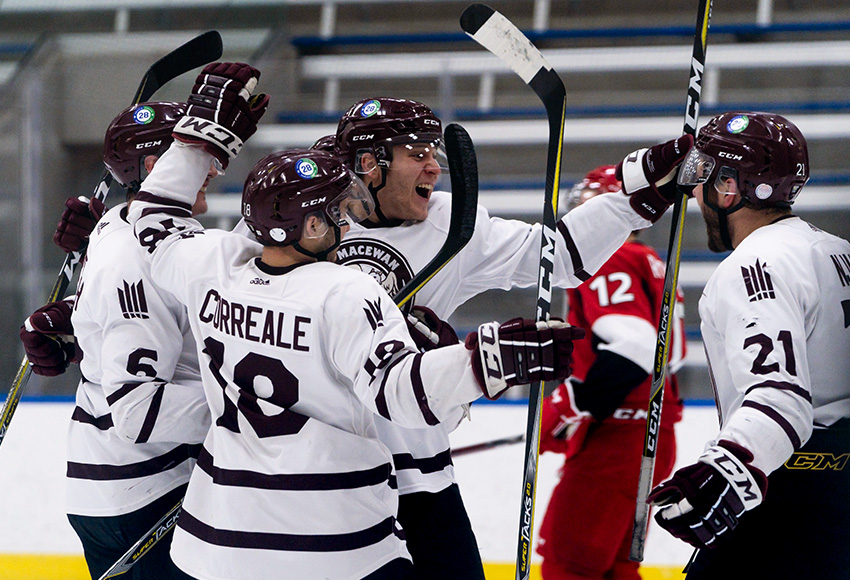 Brett Njaa, left, celebrates with Austin Shmoorkoff and other teammates after setting him up for a goal against SAIT on Feb. 20. Njaa's assist on the play would break MacEwan's program record for most in a career (Matthew Jacula photo).