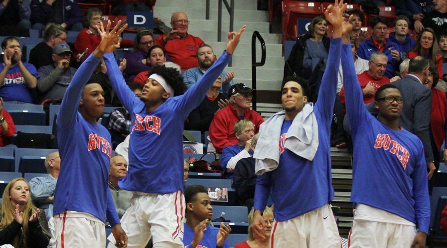 The Blue Dragon bench celebrates one of Hutch's 12 3-pointers in a 95-76 victory over Colby on Saturday at the Sports Arena. (Bre Rogers/Blue Dragon Sports Information)
