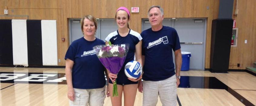 Liz Hood '15, along with her parents Jackie and Jim, at the match after recording her 1,000th career kill