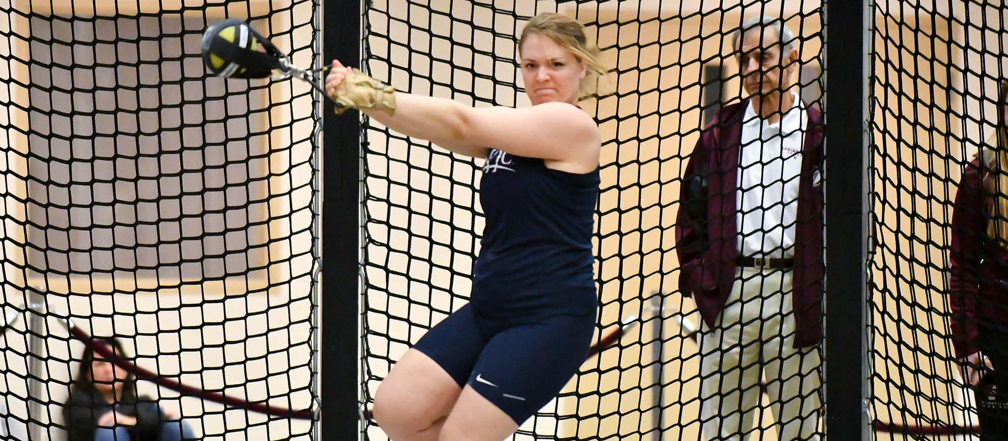 Action photo of Lyons track & field athlete, Julia Hecking.