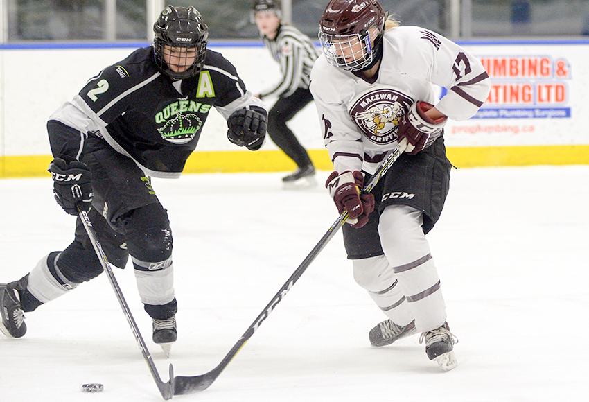 MacEwan's Kennedy Davidson battles Red Deer's Cassidy Anderson during Game 1 of the ACAC final on Thursday in Edmonton. The Griffins were unable to score in Game 2 on Saturday as RDC evened the series with a 4-0 triumph (Len Joudrey photo).