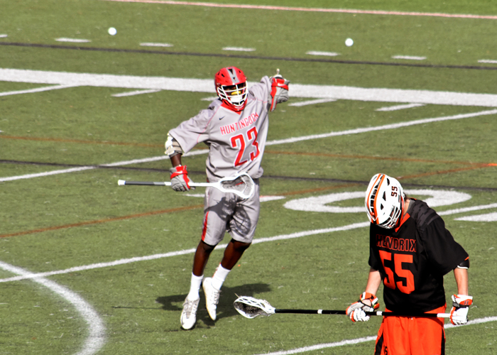 Kendrick Ballard (#23) scored three goals, including the game-winning goal in overtime, in Sunday's 6-5 win over Hendrix.