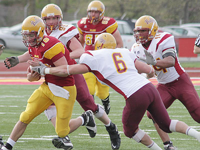 FSU quarterback Robert Banaszak runs with the ball in Friday's spring game (Photo courtesy Zeke Jennings/Big Rapids Pioneer)