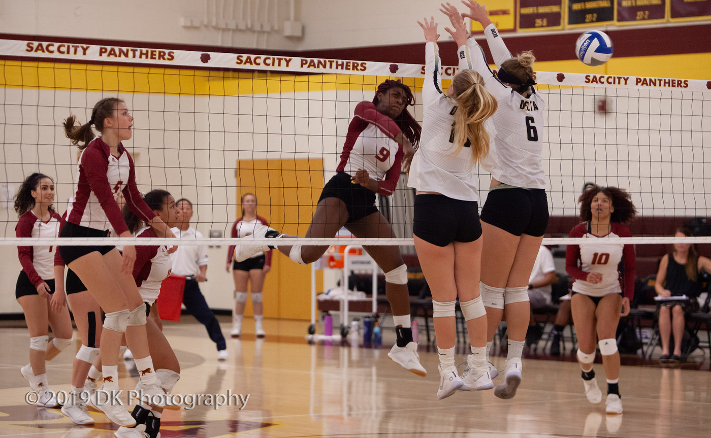 Jaylah Tate (#9), City College sophomore watches as her spike goes past the block attempt in the match against Delta College at the North Gym on Sept. 27th.