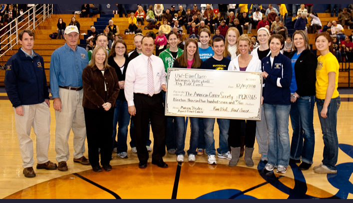 Volleyball Presents Check at Dec. 10 Basketball Game