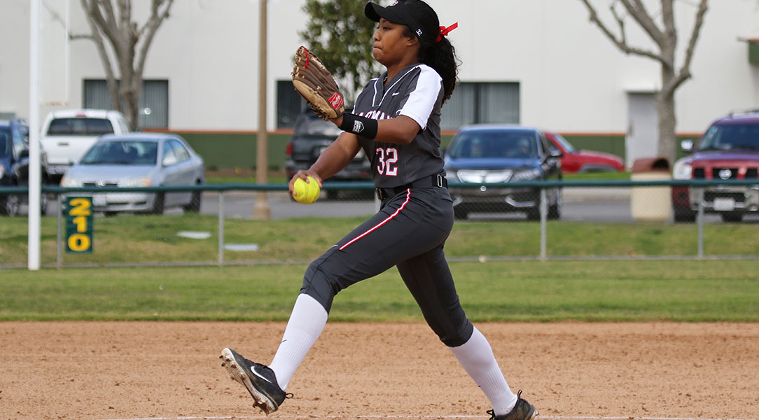 Ayanna Sanchez winds up for a pitch.