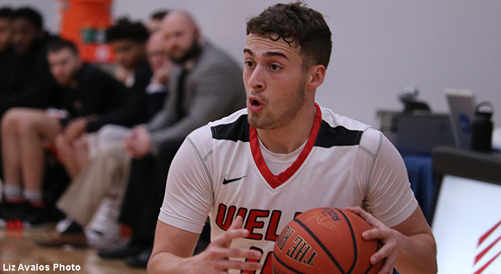 First-Place Mustangs Race Past Wells Men's Basketball