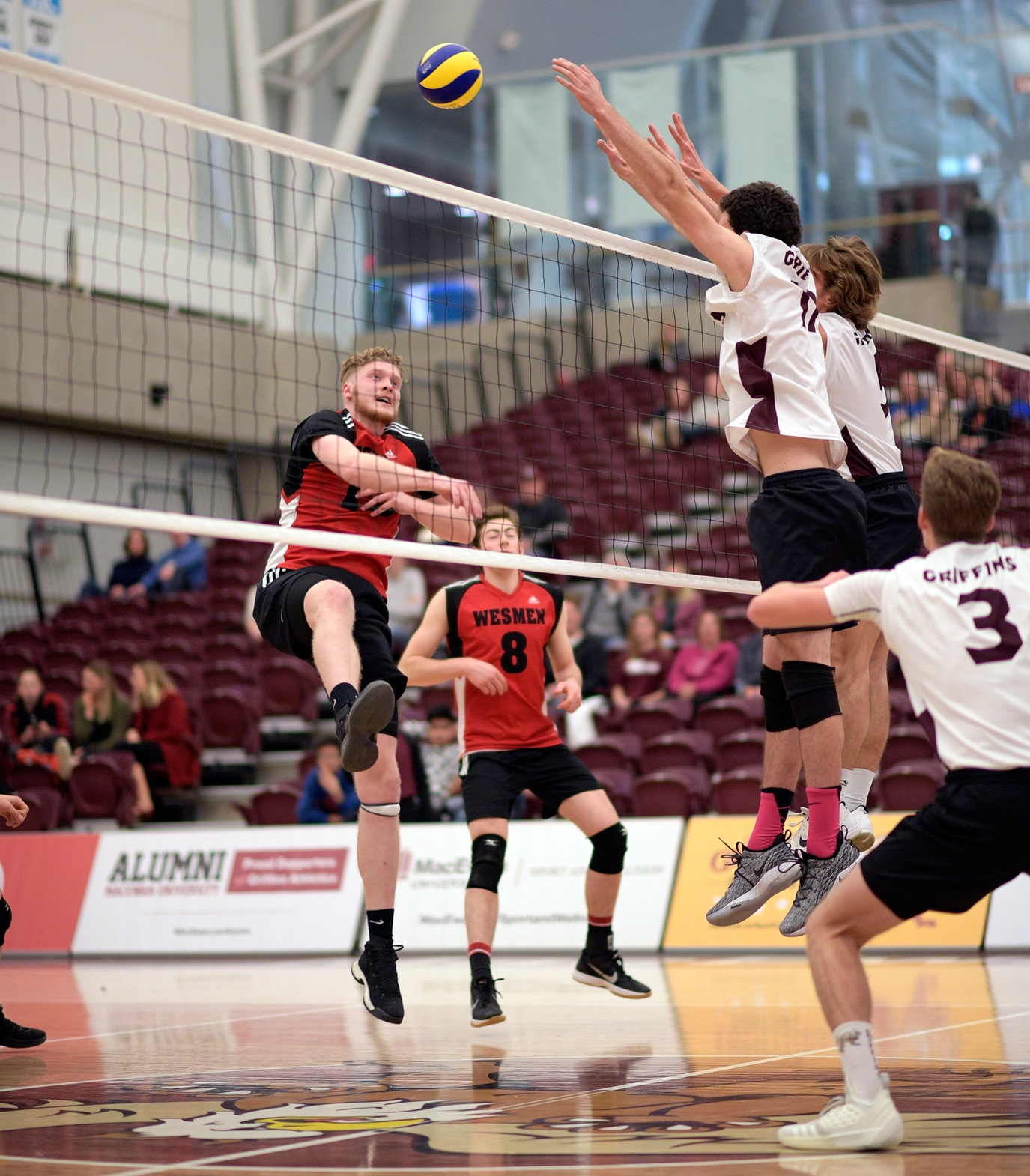 Winnipeg's Ethan Duncan swings against the MacEwan block during the Wesmen's five-set victory in Edmonton Saturday, Dec. 1, 2018. (Chris Piggott/MacEwan Athletics)