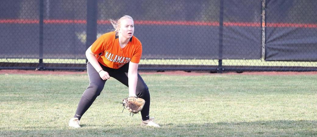 Paige Maguire playing softball.