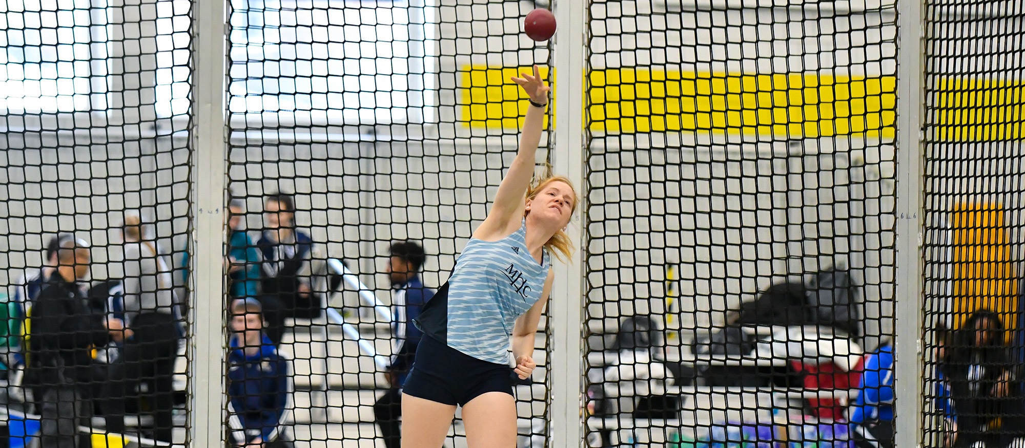 Action photo of Lyons track & field student-athlete, Charleen Theroux competing in the shot put event.